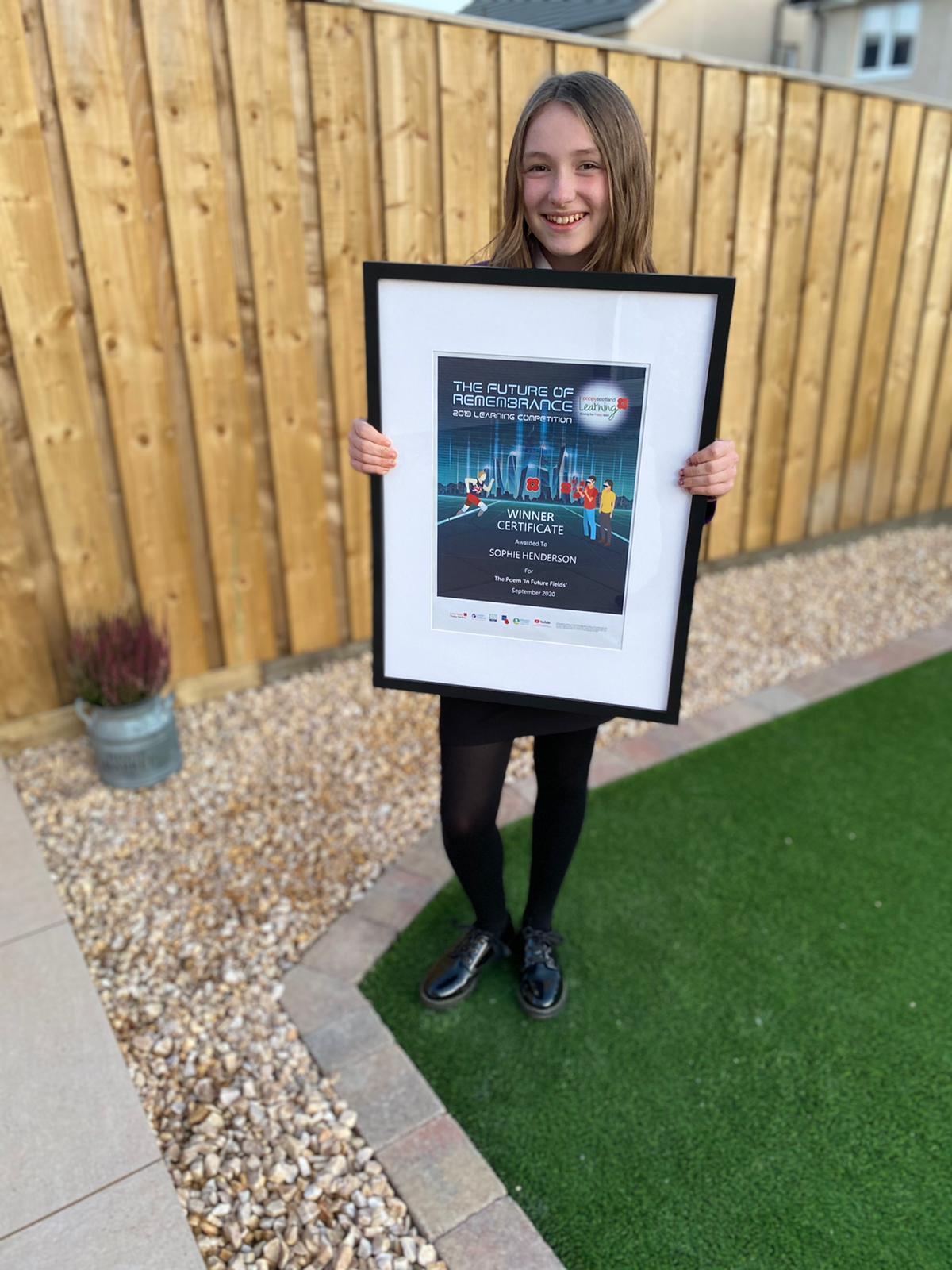 Sophie-Henderson-with-certificate-in-garden